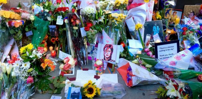 Take a look at these touching moments of mourners outside for David bowie nyc apartment